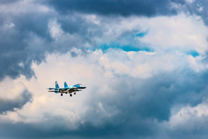 blue and white airliner in flight