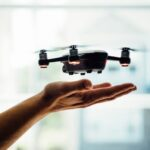 turned on black quadcopter drone